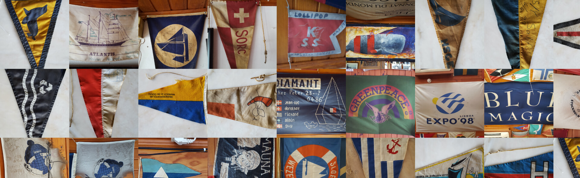 Interior of Peter Cafe Sport with some flags offered by yachts from all over the world