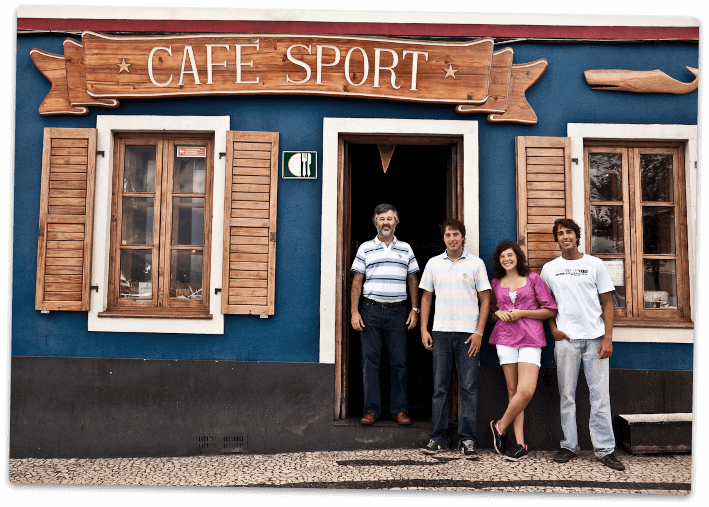 Exterior of peter cafe sport with members of the Azevedo family