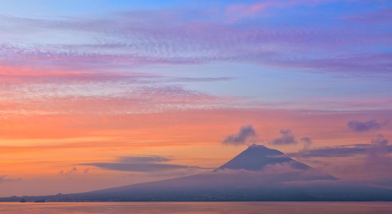 Pico Mountain is seen from Faial during sunset